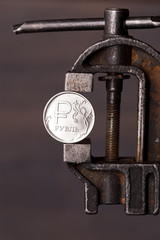 Russian ruble coin in old vise