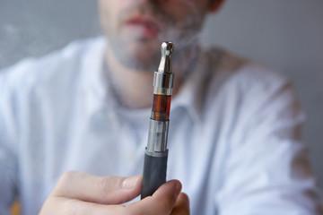 Part face man holding electric cigarette