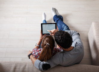 Young couple using tablet.Relaxing.