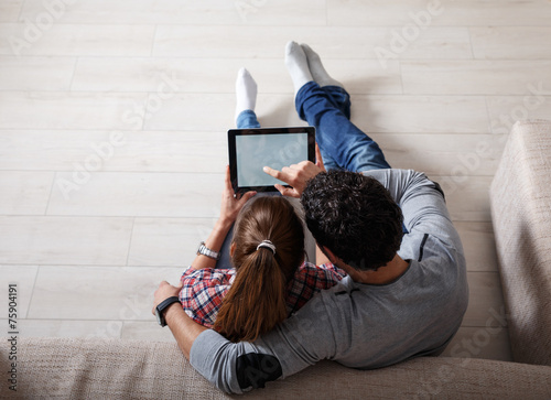 Young couple using tablet.Relaxing. - 75904191