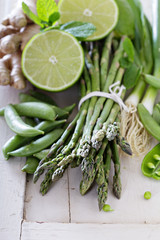 Healthy green produce on white