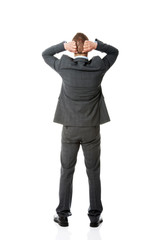 Full length businessman putting hands on the nape