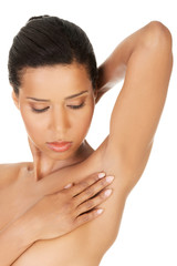 Close up on beauty woman touching her armpit