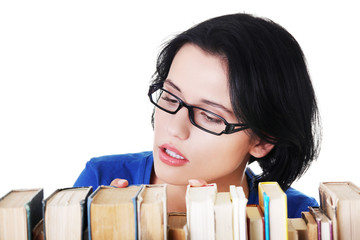 Young woman searching for an interesting book