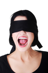 Frightened woman with black band on eyes