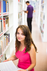 Pretty young college student in a libraryDOF; color to