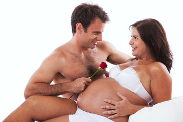 Husband embrassing his pregnant wife