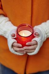 Woman holding burning candle