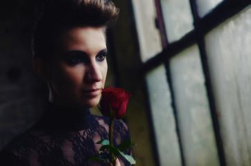 Beautiful elegant lady holding red rose