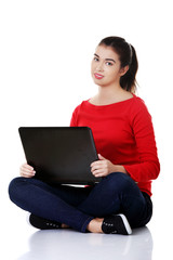 Front view woman sitting cross-legged with laptop