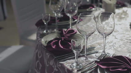Served table in restaurant with dishes and glasses