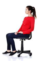 Side view student woman siting on armchair