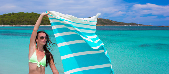 Happy woman have fun with beach towel and very happy