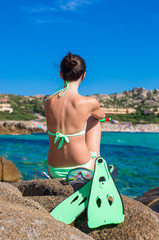 Back view of girl with equipment ready for snorkeling