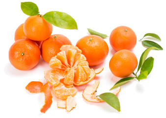 Ripe sweet tangerine with leaves and slices