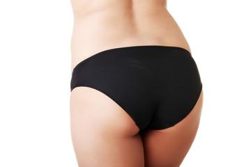 Close up on slim woman buttocks in underwear