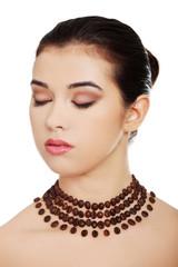 Portrait of a woman wearing beautiful necklace