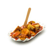 Leinwandbild Motiv currywurst mit currypulver