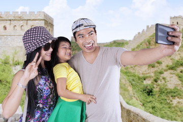 Attractive family taking pictures in the Great Wall
