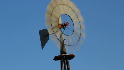 Old-fashioned windmill against blue sky