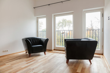 Leather black armchairs
