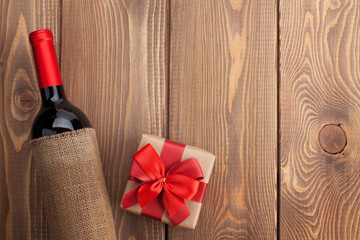 Red wine bottle and valentines day gift box