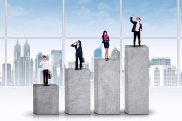 Entrepreneurs standing on business graph