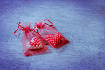 Valentine hearts in red mesh bag