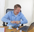 Mature man in rage while working