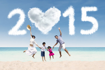 Family at beach with cloud of 2015
