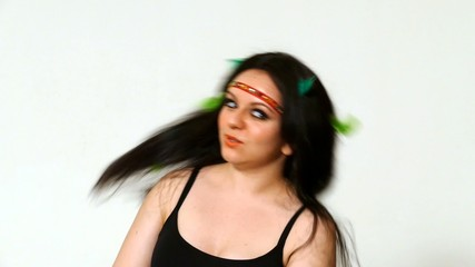 beautiful young woman face close up with hippie art make up