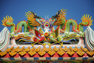 colorful dragon statue on the roof Chinese temple