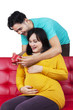 Happy expectant woman getting a gift