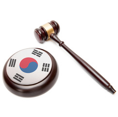 Judge gavel and soundboard with flag on it - South Korea