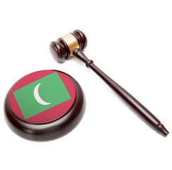 Judge gavel and soundboard with national flag on it - Maldives