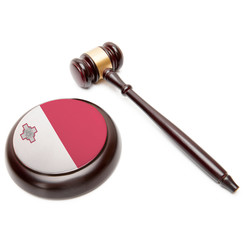 Judge gavel and soundboard with national flag on it - Malta