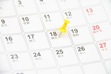 Thumb tack on calendar page