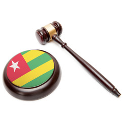 Judge gavel and soundboard with national flag on it - Togo