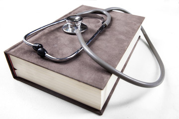 Medical book and stethoscope