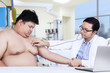 Obesity person visits doctor to checkup