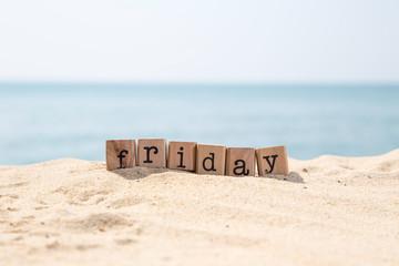 Friday word on sea sand beach