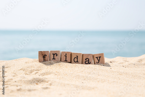 Friday word on sea sand beach - 75914735