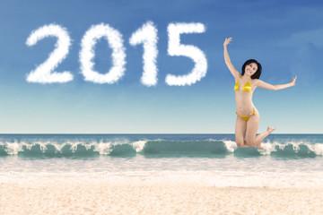 Woman in bikini enjoying new year holiday