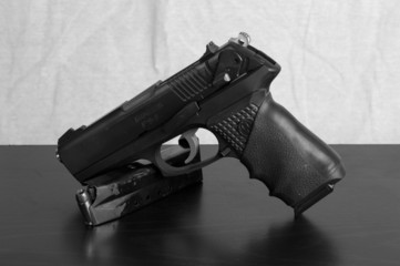 Semi-automatic pistol propped on top of a loaded magazine with b