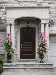 front door with flower pots