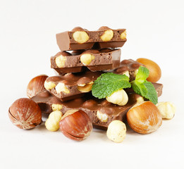 bar of chocolate with hazelnuts and mint leaves