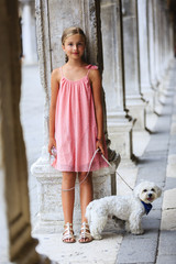 Portrait of fashion girl with dog in Venice