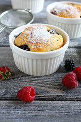 Cupcakes with blueberries and raspberries