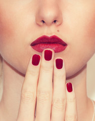 Red Sexy Lips and Nails closeup. Closed Mouth.