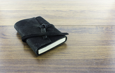 Leather notebooks on wood